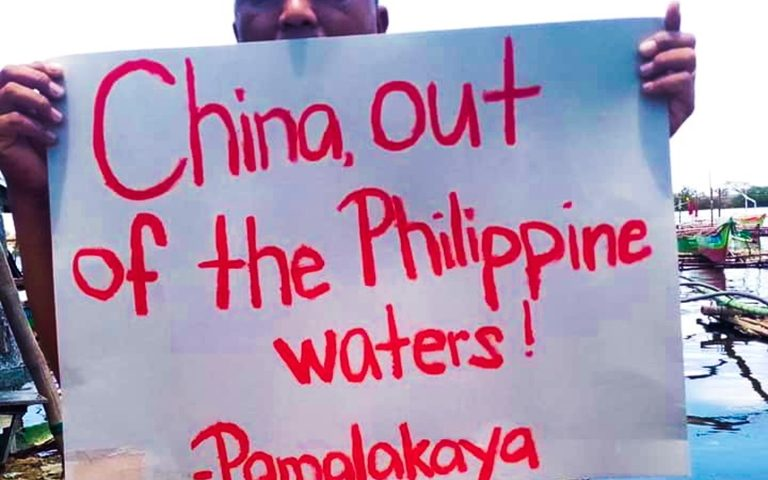 "Fisherfolk from Bacoor City call for ""China, Out of Philippine Waters!"" in marking the 2020 Earth Day."